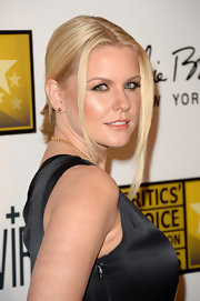 Carrie Keagan rocked a center-parted updo with casual strands left undone to frame her face.