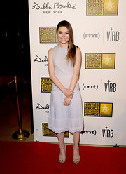 Miranda Cosgrove opted for a fun and flirty light lilac frock that featured a drop-waist pleated skirt.
