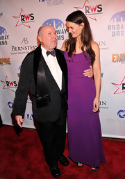 Katie looked lovely in this simple purple gown with emerald heels peeking out from underneath.