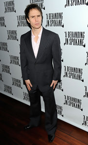 Sam sported a loose-fitting pin-striped suit with tuxedo oxfords. The actor opted to loose the tie and keep his shirt slightly unbuttoned for a more casual look.