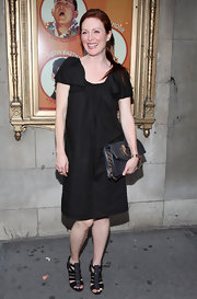 We aren't big fans of Julieanne's shapeless frock, but we do however love her black strappy sandals. Too cute!