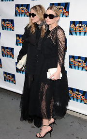 Ashley wore classic black ankle-strapped sandals with a dramatic, sheer ensemble.