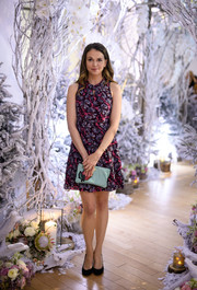 Sutton Foster channeled spring in a purple floral mini dress while attending a Winter Wonderland event.