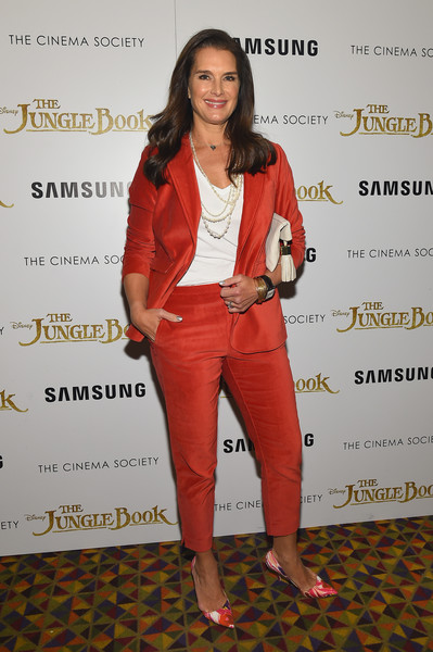 Brooke Shields Pumps [disney with the cinema society samsung host a screening of ``the jungle book,the jungle book,red,fashion,flooring,shoulder,fashion model,outerwear,formal wear,carpet,suit,girl,arrivals,brooke shields,theater,amc empire 25,new york city,disney,the cinema society samsung,screening,brooke shields,image,photography,photograph,fashion,actor,celebrity,child actor]