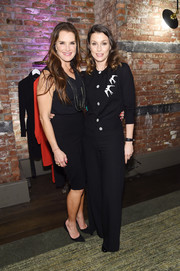 Bridget Moynahan matched her top with a pair of black trousers.
