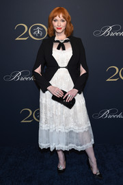 Christina Hendricks styled her look with a pair of bejeweled satin pumps.