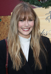 Elizabeth Olsen sported barely-there waves and eye-skimming bangs at the Brooks Brothers Holiday celebration.