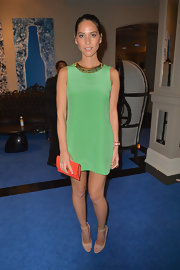 Olivia Munn's orange clutch popped against her green shift.