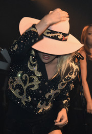 Lady Gaga was country-glam in an embellished black and gold cropped jacket by Manuel Couture during her Bud Light Dive Bar Tour in Nashville.