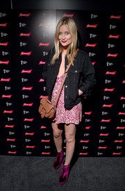 Laura Whitmore styled her outfit with a pair of purple platform booties.