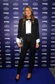Anna dello Russo tried a more toned-down style with this black Saint Laurent tux during the Bugatti and L'Uomo Vogue collection party.