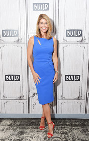 Lori Loughlin was slim and stylish in a fitted blue dress with a slashed yoke while visiting the Build Series.