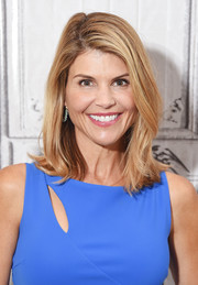 Lori Loughlin visited the Build Series wearing her hair in a side-parted style with flippy ends.