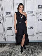 Paula Patton went for easy elegance in a black one-shoulder dress with ruffle detailing and an asymmetrical hem for her visit to Build.