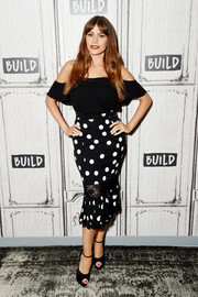 Sofia Vergara was trendy and girly in a black cold-shoulder blouse while visiting the Build Studio.