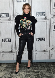 Jennifer Lopez attended the Build Series wearing an embroidered black turtleneck by Zuhair Murad.