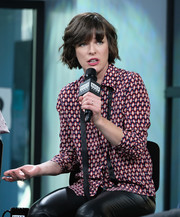 Milla Jovovich visited the Build Studio looking vibrant in a geometric-print shirt.