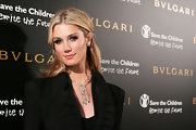 Delta Goodrem aptly accessorized with a stunning diamond chandelier necklace at the 125th anniversary celebration of Bulgari.