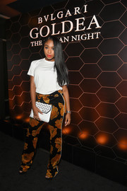 Normani Kordei kept it casual in a white tee at the 'Goldea, The Roman Night' fragrance launch.