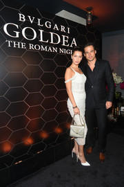 Bella Hadid attended the 'Goldea, The Roman Night' fragrance launch carrying an ultra-chic studded gold bag by Nicholas Kirkwood x Bulgari.