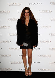 Alyson Le Borges chose this furry voluptuous fur coat to pair over a slinky LBD for a totally glam look.