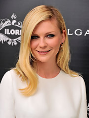 At the launch of Bulgari's Le Gemme eyewear collection, Kirsten Dunst wore her blond locks in a soft, side-swept style with subtle waves and lots of shine.