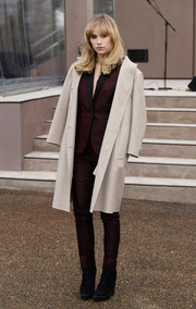 Suki Waterhouse was androgynous-chic in a cream wool coat layered over a maroon pantsuit during the Burberry Prorsum menswear show.