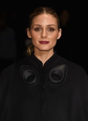 Olivia Palermo opted for a center-parted ponytail when she attended the Burberry fashion show.