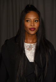 Naomi Campbell styled her long hair into a sleek half-up 'do for the Burberry fashion show.