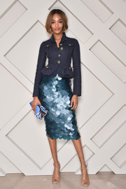 Jourdan Dunn polished off her sophisticated all-Burberry ensemble with a printed clutch.