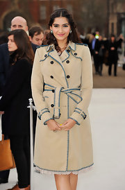 Sonam Kapoor exuded classic style in a beige trenchcoat at the Burberry fashion show.