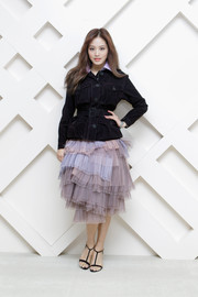 Kim Jae-Kyung toughened up her flirty skirt with a belted black suede jacket, also by Burberry.