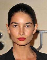 Lily Aldridge looked super striking with an almost nude face and matte red lips at the Burberry Body launch.