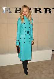 Rachel Zoe was vibrant in an aqua leather trench with black boots and a statement orange clutch for the Burberry Body Launch.