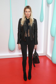 Jessica Hart was edgy in all black, consisting of a leather biker jacket, a lace blouse, and skinny jeans, at the launch of Burberry's DK88 bag.