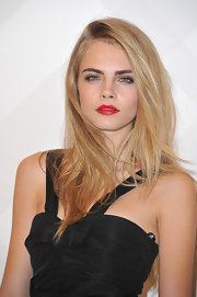 Cara Delevingne looked pretty with her layered hair side swept at the Burberry store launch.
