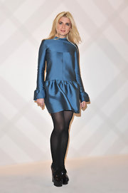 Cecile Cassel wore a rich iridescent blue cocktail dress with a drop-waist and ruffled cuffs for the Burberry Boutique opening.