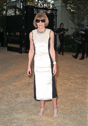 Anna Wintour made a stylish appearance at the Burberry London in Los Angeles show wearing a shimmery gold and black cocktail dress.