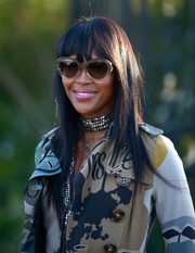 Naomi Campbell wore her hair in sleek straight layers with wispy bangs during the Burberry London in Los Angeles show.