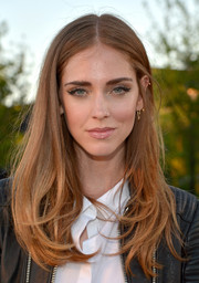 Chiara Ferragni looked cute with her center part and wispy ends at the Burberry London in Los Angeles show.
