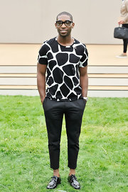 Tinie Tempah chose classic black skinny pants to balance out his printed top.