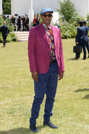 Samuel L. Jackson completed his vibrant look with a pair of blue slacks.