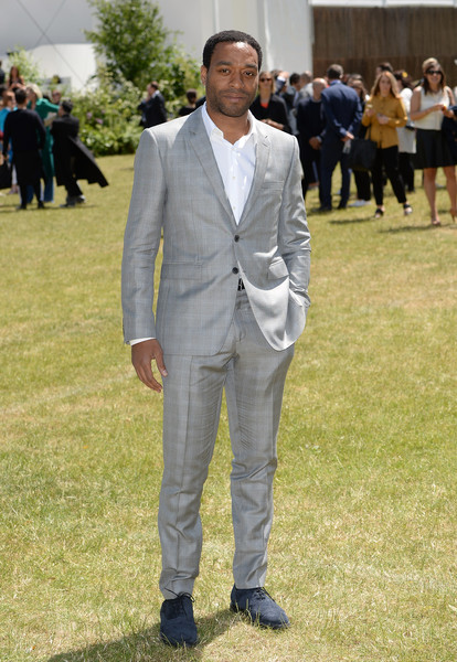 Chiwetel Ejiofor looked dapper in a subtly patterned gray suit at the Burberry Menswear fashion show.
