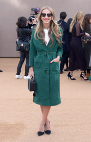 Harley Viera-Newton cozied up in a green trenchcoat for the Burberry fashion show.