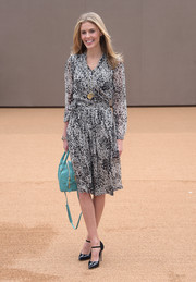 Donna Air kept it classic and stylish in a monochrome wrap dress during the Burberry fashion show.