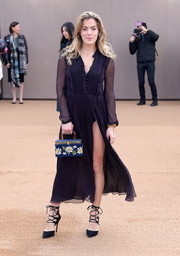 Chelsea Leyland donned a dark purple shirtdress with a panty-flashing slit for the Burberry fashion show.