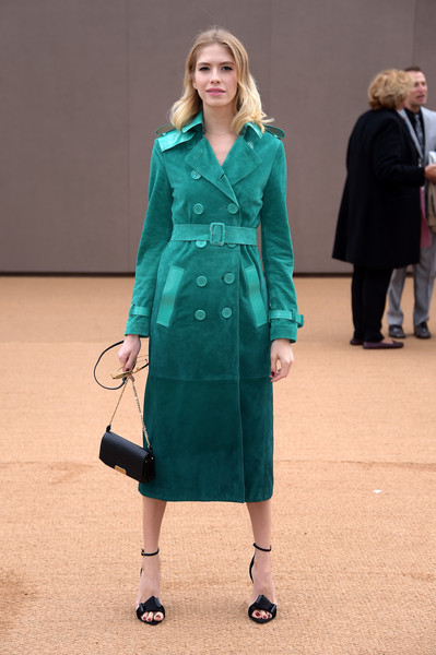 Elena Perminova styled her trench with a pair of architectural-detailed ankle-strap sandals.