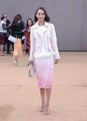 Amanda Strang arrived for the Burberry fashion show wearing a pale pink leather moto jacket.