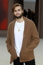 Douglas Booth's slouchy tan sweater gave him a casual hipster-feel at the Burberry Prorsum runway show in London.