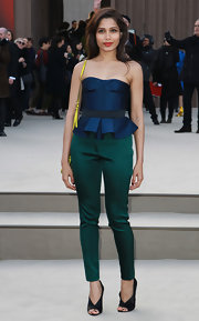 Freida Pinto chose a strapless navy peplum top for a fun and flirty look at the Burberry Prorsum runway show in London.
